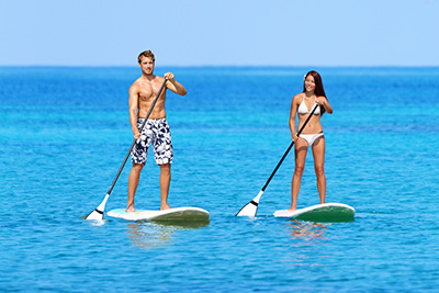 couple doing paddling on the sea
