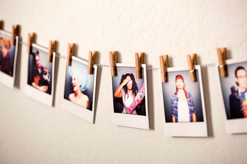 instagram for wedding decorations: polaroid photos hanging on a clothes line