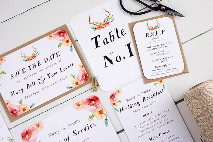 Wedding stationery by Nina Thomas with flowers