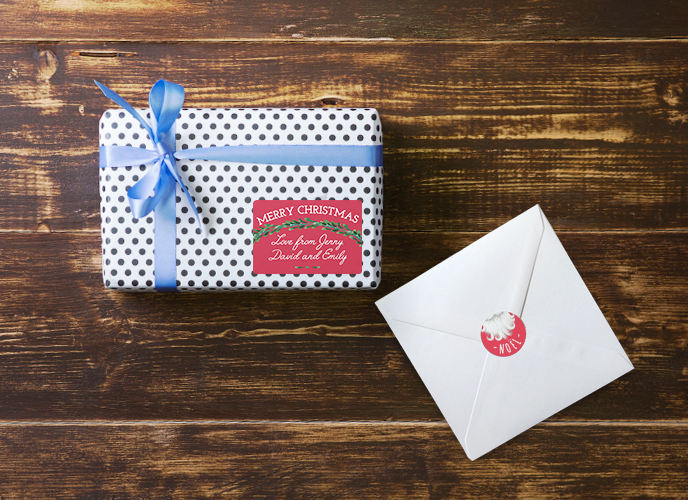 christmas print list: stickers for closing envelopes and labels as gift tags in a present