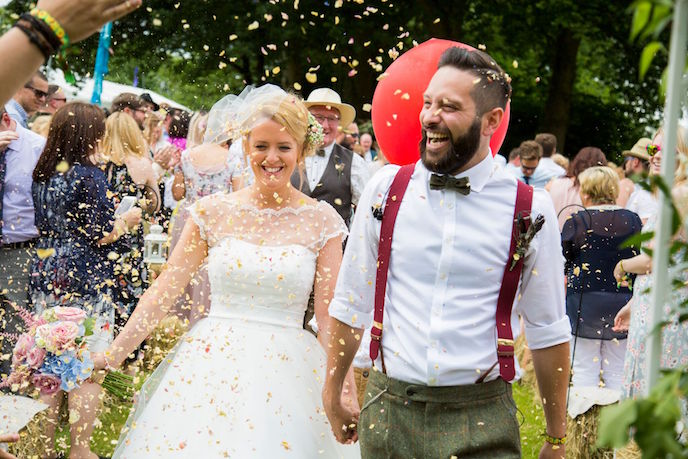 Event with I do festival featuring a just married couple with confetti